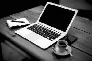 Laptop, coffee and notepad