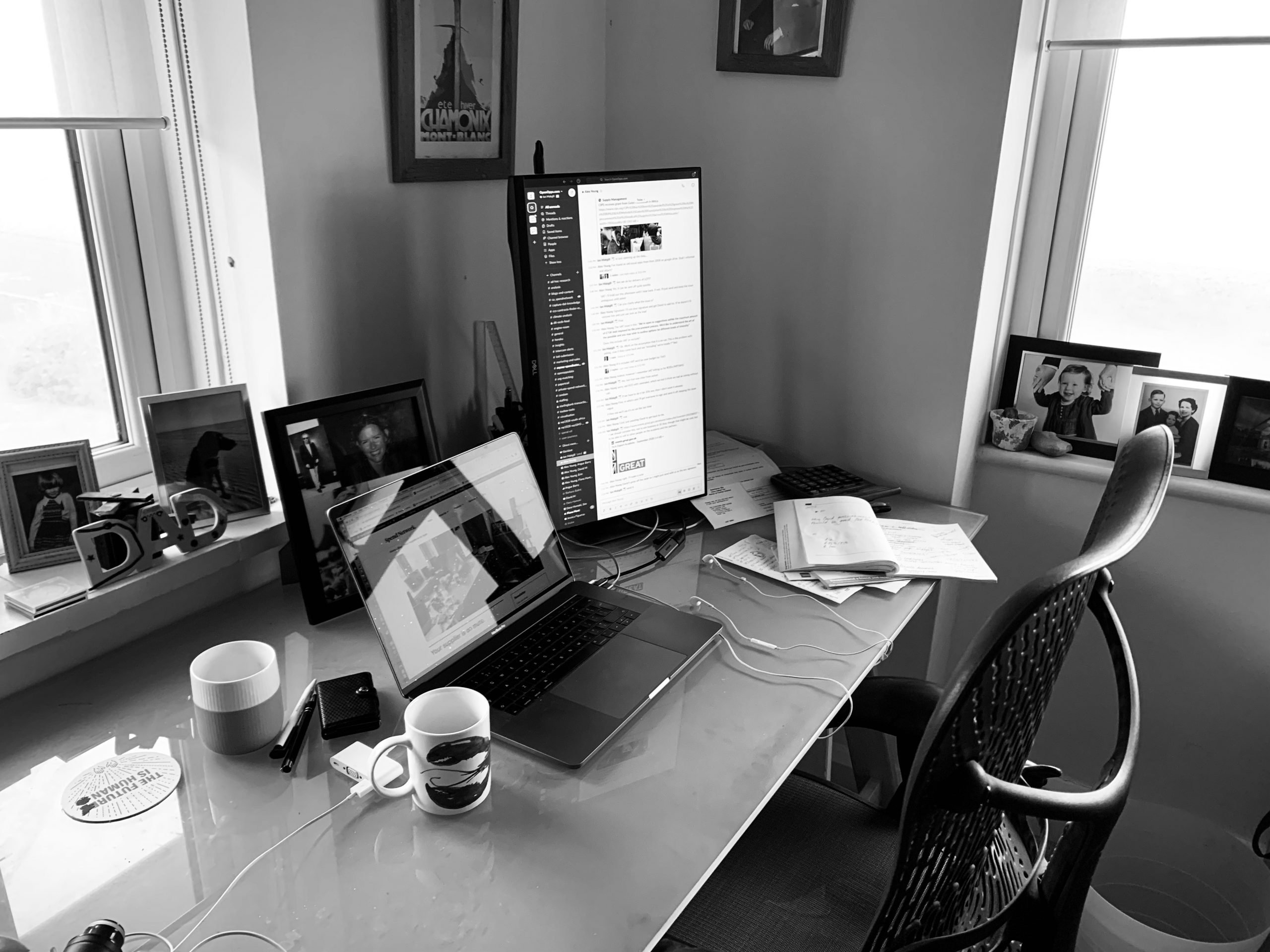 Desk with screens, chair and cups