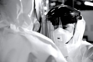 Health worker in a mask and visor